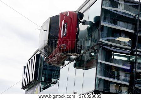 Bordeaux , Aquitaine / France - 10 17 2019 : Mini Red Car Fixed To Building Mini Cooper Dealership S