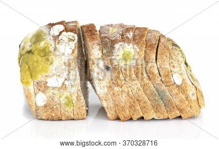Mildew On A Sliced Loaf Of Bread. Old Loaf Of Bread, Covered With Mildew Isolated On White Backgroun