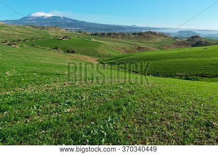 hill meadow landscape in Sicily on background Etna natural landmark Unesco (from the southern side)