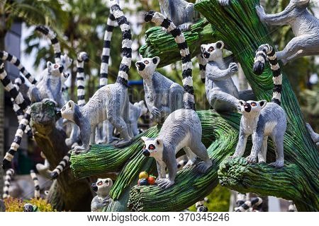 Pattaya, Thailand -​ May 2, 2019​: Statue Lemurs Zoo Valley​ In  Nong Nooch​ Garden, Tourists ​ Trav
