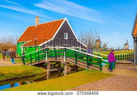 Zaanse Schans, Netherlands - April 1, 2016: Traditional Village, Tourists Walking Over The Bridge In