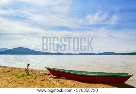 Summer landscape - the shore Zyuratkul Lake Southern Urals, Russia, summer nature scene. Summer water landscape, summer lake, beautiful summer background. Colorful summer view