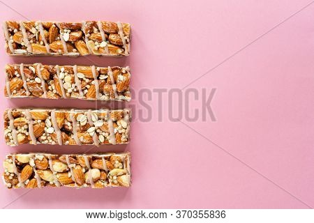 Almond Protein Granola Bars On Pink Background. Healthy Snack For Fitness, Sport People