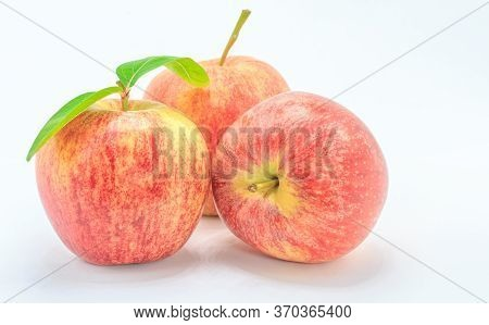 Fresh Red Apple With Leaf. Isolated On White Background
