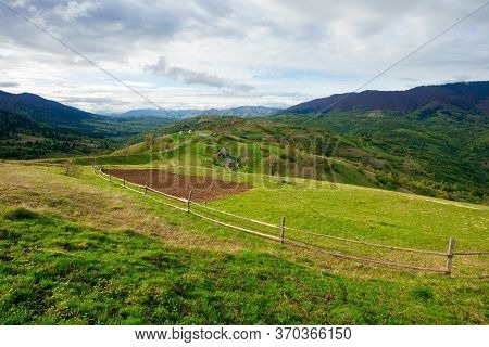 Rural Fields On Mountain Hills. Beautiful Rural Landscape Of Carpathian Nature On A Cloudy Day. Path