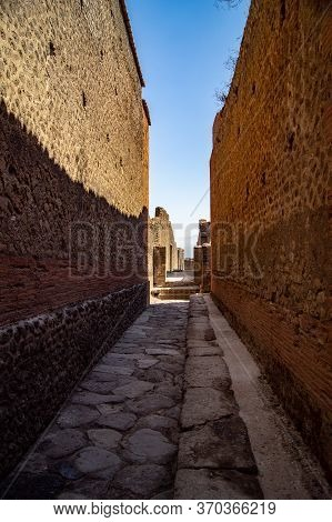 Strolling Through The Ruins Of Pompeia, We Discover Narrow Streets