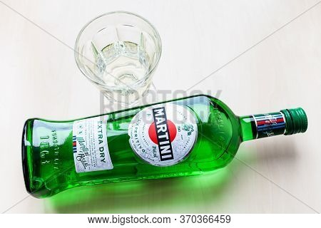 Moscow, Russia - May 23, 2020: Top View Of Lying Bottle Of Martini Extra Dry And Glass On Light Brow