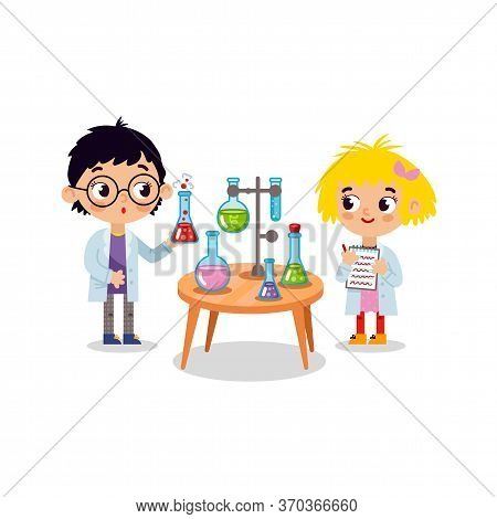 Chemistry Laboratory. Little Boy And Girl Scientist In Classroom At Chemistry Lesson. School Chemica