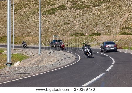Alta, Russia - 06.02.2020: Mountain Asphalt Road In Altai With Three Motorbikes And Bikers In Helmet