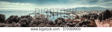 Panoramic Image Of Malaga Seaport With A Lot Of Moored Nautical Vessels Yachts And Boats, View From