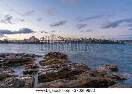 Sydney Harbor Skyline At Sunset With Sydney Harbor Bridge, Nsw, Australia.
