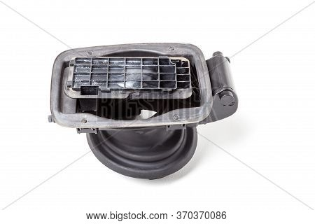 The Removed Spare Part From The Car On A White Isolated Background Is A Black Plastic Mechanism For