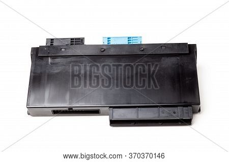 The Disassembled Spare Part From The Car On A White Isolated Background Is A Black Plastic Electroni