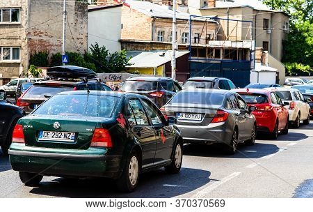 Car Traffic At Rush Hour Stopped At Red Light. Car Pollution, Traffic Jam In The Morning And Evening