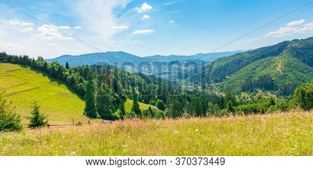 Fields And Meadows Of Countryside  In Summer. Idyllic Mountain Scenery On A Sunny Day. Grass Covered
