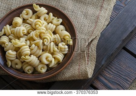 Serving Uncooked Insalatonde Pasta In A Bowl On Burlap. Ingredients Traditional Mediterranean Food O