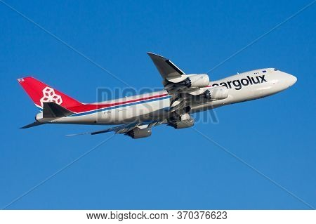 Hong Kong / China - December 1, 2013: Cargolux Boeing 747-8 Lx-vca Cargo Plane Departure And Take Of