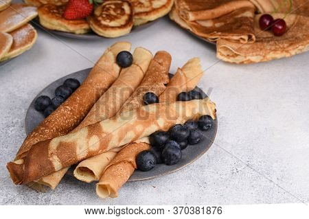 Variety Of Pancakes With Berries, Honey And Jam. Different Kind Of Pancakes. Traditional And Tiny, C
