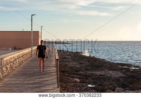 Colonia De Sant Jordi, Balearic Islands/spain; June 2020: Girl Walking On The Colonia De Sant Jordi