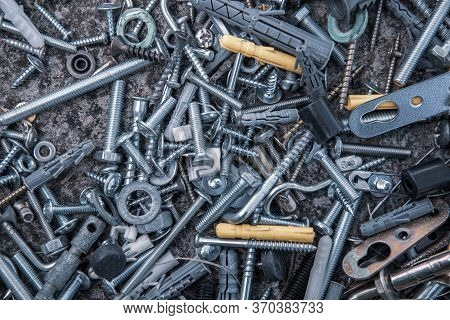 Blue Filter Flat Lay Of Steel Bolts And Nuts, Hooks And Dowels On Grunge Stone Background With Copy