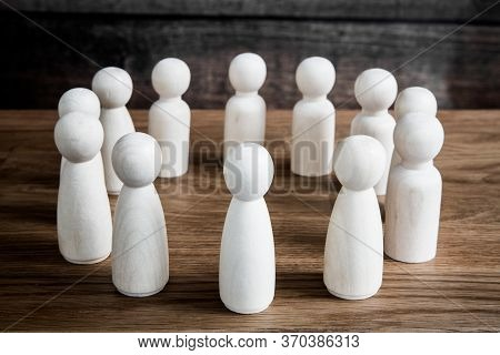 A Business Or Social Concept Of Generic Figures Grouped Into A Circle During A Meeting, Conference O