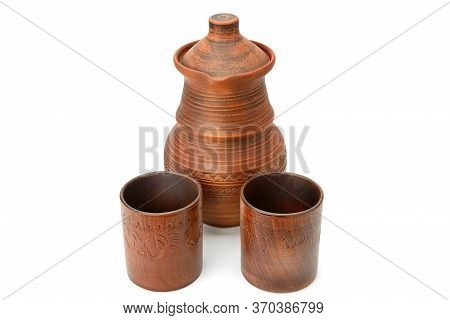Beautiful Clay Jug And Two Ceramic Glasses Isolated On A White Background.