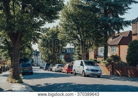 London, Uk - May 30, 2020: Cars Parked In Front Of A Row Of Houses On A Street In Palmers Green, A S
