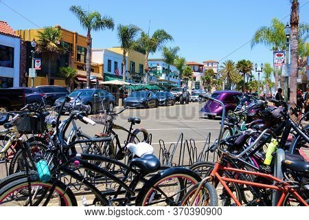 June 7, 2020 In Huntington Beach, Ca:  Bikes Parked By Cyclists Besides The Street Surrounded By Sto