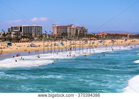 June 7, 2020 In Huntington Beach, Ca:  Modern Resort Hotels Surrounding A Vast Sandy Beach And The P
