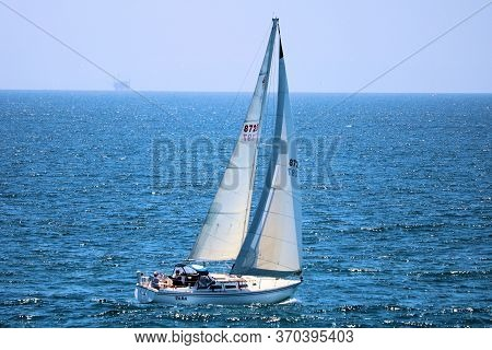 June 7, 2020 In Huntington Beach, Ca:  Sail Boat Sailing Offshore The California Coast Using The Pro