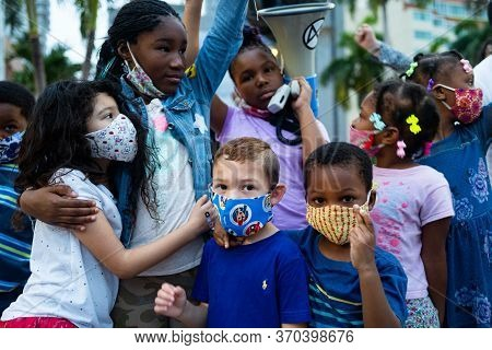 Miami, Fl, Usa - June 7, 2020: White And Black Children Together. Schoolchildren And Teenagers At A