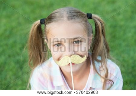 All The Taste Of Being A Girl. Happy Girl Hold Fake Mustache Outdoors. Child Girl With Party Props.