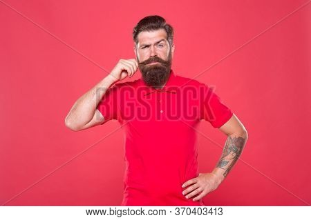 Occupy Upper Lip. Bearded Man Twirl Moustache Red Background. Hipster Wear Long Beard And Moustache.