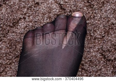 Black Nylon Tights Or Socks Torn On The Thumb