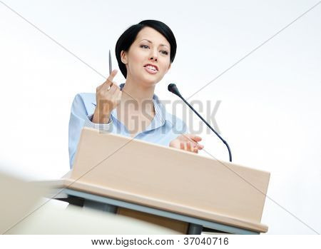 Female speech maker at the podium. Business training