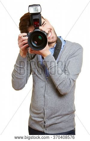 Young man photographs with a large digital camera