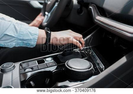Business Woman Holds Her Hand On The Gear Selector Automatic Transmission