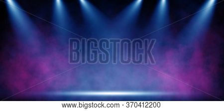 Stage light with colored spotlights and smoke