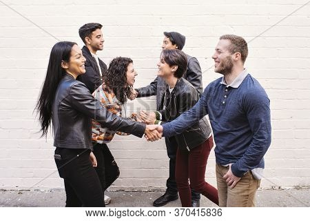Six Friends Reunite And Shake Hands In The City - Happy - Friendly - Daytime