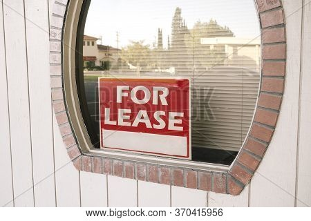 Business Office With A For Lease Sign In The Window - Down Economy - Covid 19 - Pandemic