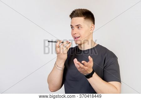 A Young Man, A Guy Talking To A Friend On The Phone, Recording A Voice Message Or A Note In A Smartp