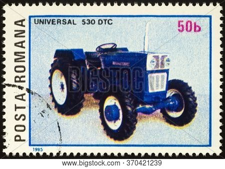 Moscow, Russia - June 06, 2020: Stamp Printed In Romania Shows Agricultural Tractor Universal 530 Dt