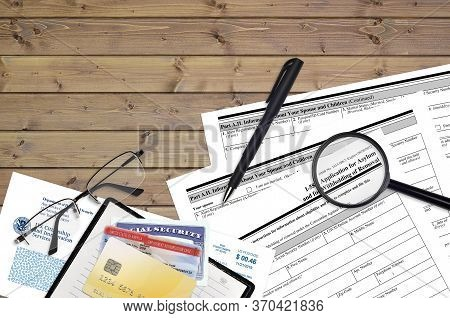 Uscis Form I-589 Application Of Asylum And For Withholding Of Removal Lies On Flat Lay Office Table