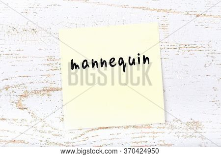 Yellow Sticky Note On Wooden Wall With Handwritten Inscription Mannequin