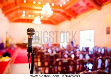 Microphone With Blurry Indoor Location For Buddhist Activities.