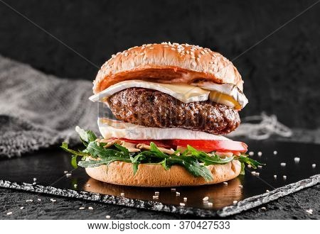 Tasty Burger With Cheese Brie, Blue Cheese, Mozzarella, Tomatoes And Arugula On Slate Black Backgrou