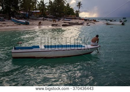 Mantanani Island, Sabah, Malaysia-circa September, 2017: Unidentified Fisherman In A Boat Trying To