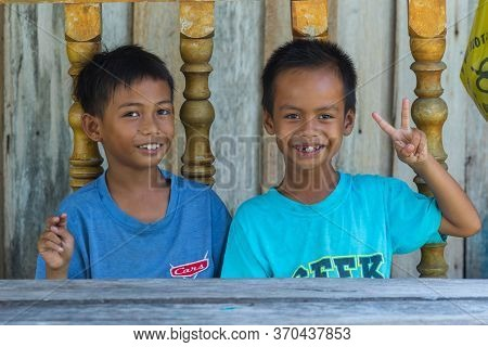 Portrait Image Of Unidentified Local Mantanani Island Happy Kids Smile