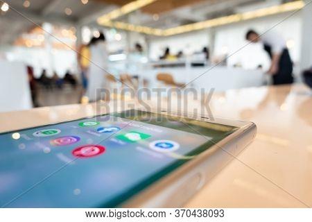 Nantou, Taiwan - March 27th, 2020: using social media at a smartphone in a restaurant, Nantou, Taiwan, Asian