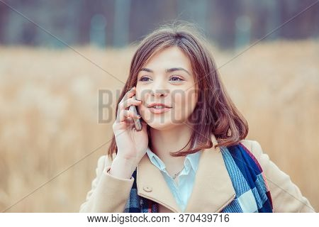 Phone Talk. Closeup Portrait. Happy Woman Talking On Mobile Phone Outside Outdoors On Autumn Park Ba